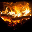 Firewood in fire - Foto Stock
