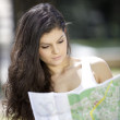 Girl with map - Stock Photo