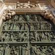 Decorated bronze door of Duomo di Milano - Stock Photo