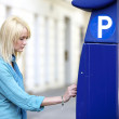 Girl at parking ticket machine - Stock Photo