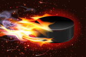 Hockey Puck On Fire — Stock Vector