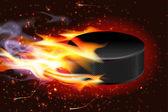 Hockey Puck On Fire — Stock Vector