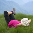 Relaxing on the grass over the mountains — Stock Photo #11332963