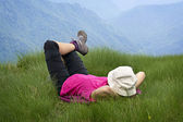 Relaxing on the grass over the mountains — Stock Photo