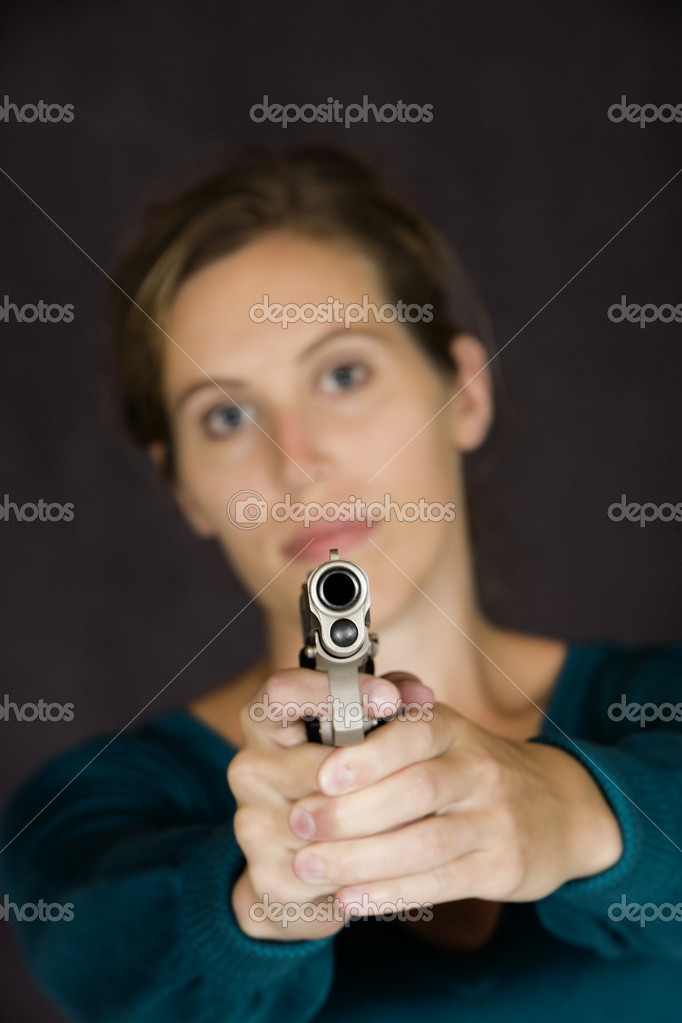 Woman defending herself with handgun — Stock Photo #10856817