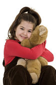 Child holding teddy bear — Stock Photo