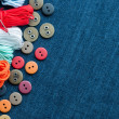 Blue jeans background with buttons and threads. — Stock Photo