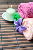 Spa towels rolls and flower. — Stock Photo
