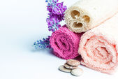 Spa towels rolls, flower and stones. — Stockfoto