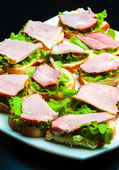 Closeup of delicious ham and salad canapes — Photo