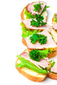 Closeup ham, salad and parsley canapes — Stock Photo