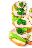Closeup ham, salad and parsley canapes — Stock Photo