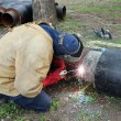 Welder Welding Two Big Pipes — Stock Photo