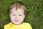 Toddler in the grass — Stock Photo