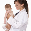 Female doctor and a baby — Stock Photo