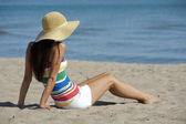 Woman in beach wear — Stockfoto