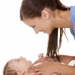 Female nurse with baby — Stock Photo