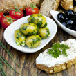 Green olives with fresh bread and herbs — Stock fotografie