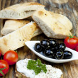 Green olives with fresh bread and herbs — Stock Photo #10841428