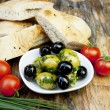 Green olives with fresh bread and herbs — Stock Photo #10841443