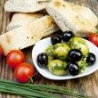 Green olives with fresh bread and herbs — Stock Photo #10841453