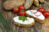 Fresh bread with herb curd dinner — Stock Photo