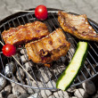 Barbecue grill wiht meat outside in summer — Stock Photo