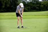 Woman is playing golf on course summer — Stock Photo