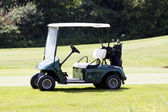 Golf car on a course in summer — Stock Photo