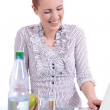 Young business woman on computer with snack isolated — Stock Photo