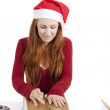 Young woman is packing present for christmas isolated — Stock Photo