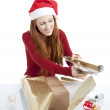 Young woman is packing present for christmas isolated — Stock Photo #11598256