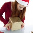 Young woman is packing present for christmas isolated — Stock Photo #11598299