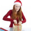 Young woman is packing present for christmas isolated — Stock Photo #11598304