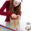 Young woman is packing present for christmas isolated — Stock Photo #11598342