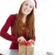 Young woman is packing present for christmas isolated — Stock Photo #11598345