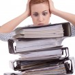 Business woman in office looks at unbelievable folder stack - Stock Photo
