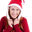 Smiling young woman at christmastime in red clothes isolated — Stock Photo #11598700