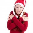 Smiling young woman at christmastime in red clothes isolated — Stock Photo