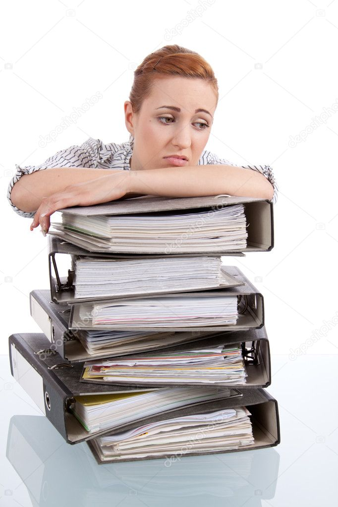 Business woman in office looks at unbelievable folder stack isolated on white — Stock Photo #11598893