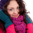 Beautiful young smiling girl with hat and scarf in winter - Stock Photo