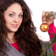 Beautiful brunette woman is decorating a christmas tree — Stock Photo #11725983