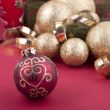 Beautiful golden christmas decoration on red background — Stock Photo #11918365