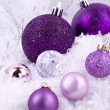 Beautiful christmas decoration in purple and silver on white snow — Stock Photo