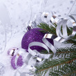 Beautiful christmas decoration in purple and silver on white snow — Photo