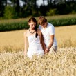 Happy couple in love outdoor in summer on field — Stock Photo #12081501