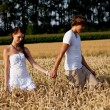 Happy couple in love outdoor in summer on field — Stock Photo