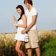 Stock Photo: Happy couple in love outdoor in summer on field