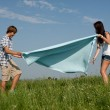 Young couple outdoor in summer on blanket in love — Stock Photo #12081654