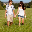 Young love couple smiling outdoor in summer - Stock Photo